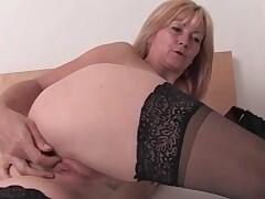horny blonde milf in black stockings cums